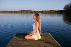 Beautiful woman doing yoga exercise outdoors Stock Photography