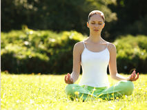 Beautiful Woman doing Yoga Exercises in the Park. Royalty Free Stock Photography