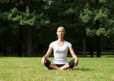 Beautiful woman doing yoga exercises Stock Photo