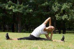 Beautiful woman doing yoga exercises Royalty Free Stock Photos