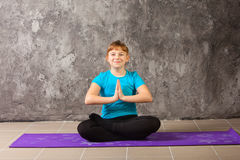Beautiful woman doing yoga on gray background Royalty Free Stock Photo