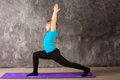 Beautiful woman doing yoga on gray background Royalty Free Stock Photography
