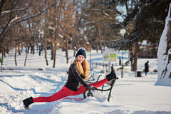 Beautiful woman doing yoga outdoors in the snow stock photography