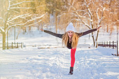 Beautiful woman doing yoga outdoors in the snow stock photos