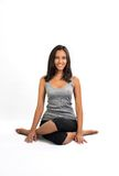 Beautiful woman doing Yoga pose (ansana) Stock Photo