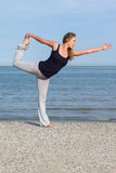 Beautiful woman doing yoga at the seaside Royalty Free Stock Photography