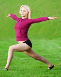 Beautiful woman doing yoga stretching exercise Stock Photography