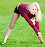 Beautiful woman doing yoga stretching exercise Royalty Free Stock Photography
