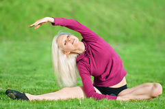 Beautiful woman doing yoga stretching exercise Royalty Free Stock Photos