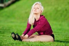 Beautiful woman doing yoga stretching exercise Stock Photos