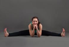Beautiful woman doing yoga  upavishta konasana. Beautiful woman doing yoga   upavishta konasana on a gray background Stock Images