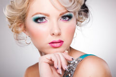 Beautiful woman with doll face wearing make-up Stock Image