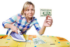 Beautiful woman with dollars and iron Stock Images