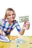Beautiful woman with dollars and iron Stock Photography
