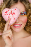 Beautiful woman with donut in face Stock Photo