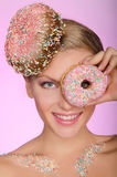 Beautiful woman, donut on head and front of eye Stock Images