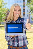 Beautiful woman downloading something from internet using laptop Stock Photos