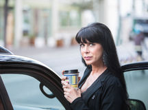 Beautiful Woman Downtown with Coffee Royalty Free Stock Photo
