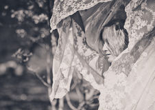 Beautiful woman draped in filmy fabric Stock Images