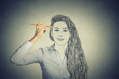 Beautiful woman drawing self portrait face Royalty Free Stock Photos