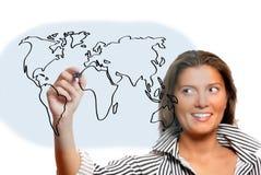 Beautiful woman drawing world map Royalty Free Stock Photos