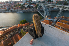 Beautiful woman with dreadlocks on the viewing platform opposite the Dom Luis I bridge across the Douro river in Porto Royalty Free Stock Image