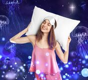 Beautiful woman dreaming about underwater world while sleeping, night starry sky with full moon on background