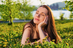 Beautiful woman dreams of in the summer Park Stock Image