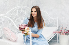 Beautiful woman in dress with bouquet flowers Royalty Free Stock Images