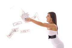 Beautiful woman in a dress catching money Stock Photography