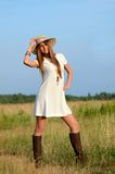 The beautiful woman in a dress in the field Stock Images