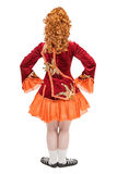 Beautiful woman in dress for Irish dance back pose isolated. On white Stock Photos