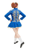 Beautiful woman in dress for Irish dance back pose isolated. On white Stock Photo
