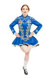 Beautiful woman in dress for Irish dance jumping isolated. On white Royalty Free Stock Photo