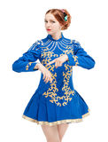 Beautiful woman in dress for Irish dance pointing on hand isolat. Ed on white Stock Photo