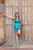 Beautiful woman in the dress in old wooden door Royalty Free Stock Photo