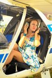 Beautiful woman in dress the pilot in a cockpit of the ultralight plane Royalty Free Stock Photos