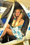 Beautiful woman in dress the pilot in a cockpit of the ultralight plane Stock Images