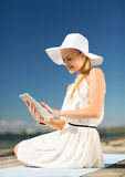Beautiful woman in a dress with tablet pc Stock Image