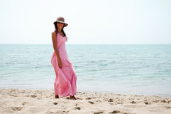 Beautiful woman with dress on a tropical beach Stock Images