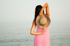 Beautiful woman with dress on a tropical beach Royalty Free Stock Image