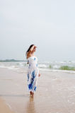 Beautiful woman in dress walking Royalty Free Stock Photo