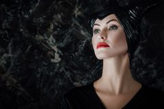 Beautiful woman dressed as Maleficent Royalty Free Stock Photo
