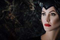 Beautiful woman dressed as Maleficent Royalty Free Stock Image