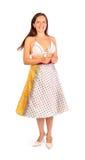 Beautiful woman dressed in bikini and skirt smiles Stock Photography