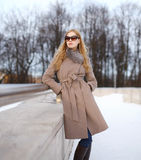 Beautiful woman dressed a coat and sunglasses Stock Image