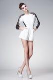 Beautiful woman dressed elegant posing glamorous - studio fashion shot Royalty Free Stock Image