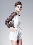 Beautiful woman dressed elegant posing glamorous - studio fashion shot Royalty Free Stock Photos