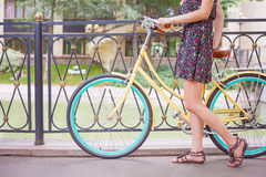 Beautiful woman dressed in fashion dress travel by vintage bicycle royalty free stock images