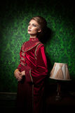 Beautiful woman dressed vintage clothes in retro interior Stock Photography